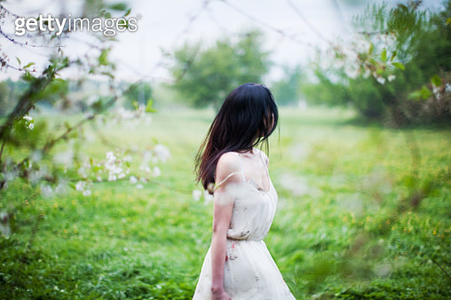 Young woman portrait in spring park - gettyimageskorea
