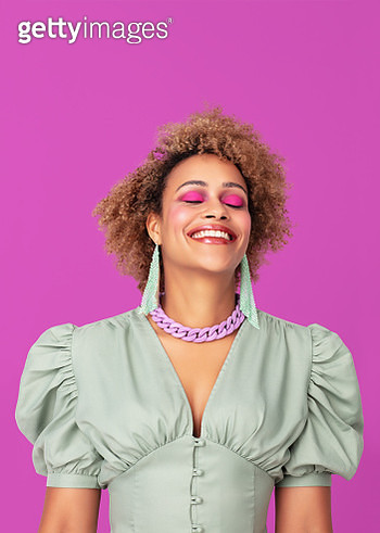 Portrait of a woman on purple background looking happy with closed eyes. - gettyimageskorea