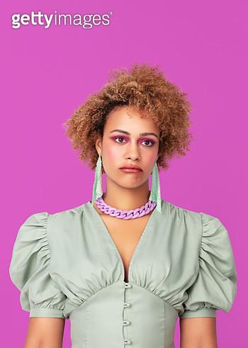 Portrait of a woman on purple background looking moody. - gettyimageskorea