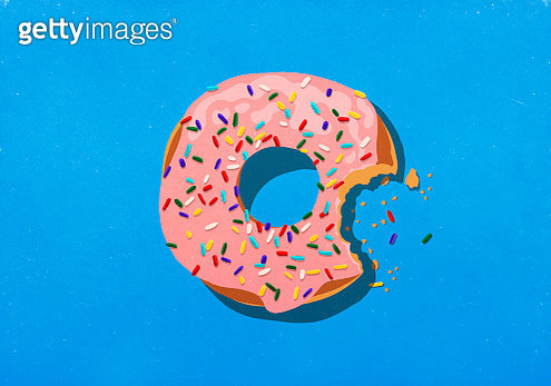 Missing bite from donut with sprinkles - gettyimageskorea