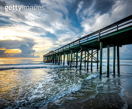 Pier at Sunrise with incoming tide - gettyimageskorea