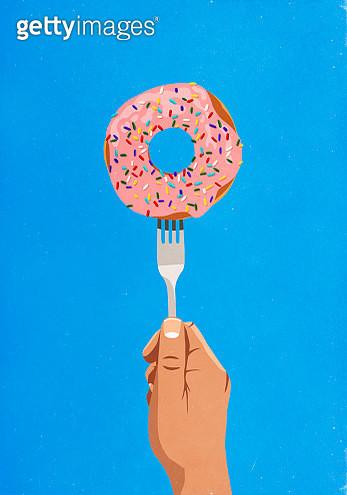 Fork piercing donut with sprinkles - gettyimageskorea