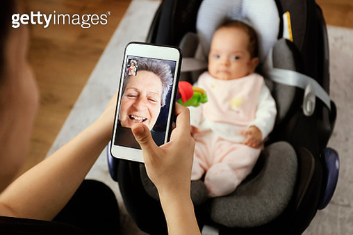 Grandmother having video call with granddaughter - gettyimageskorea