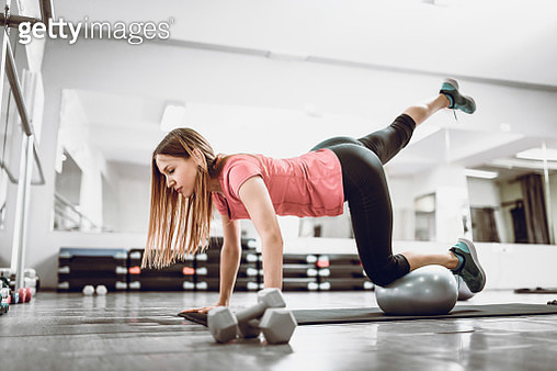 Leg Exercise With Fitness Ball - gettyimageskorea