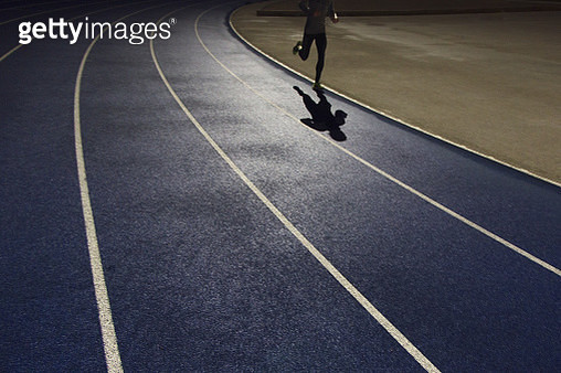 Shadow of a runner on a running track - gettyimageskorea