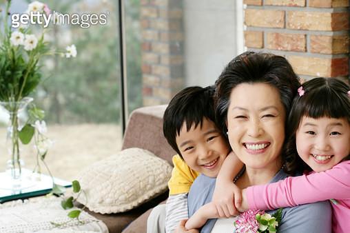 Children (6-11) embracing grandmother, smiling, portrait - gettyimageskorea
