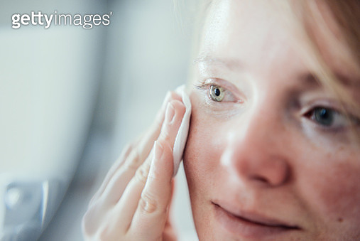 Woman cleaning face from make up. - gettyimageskorea