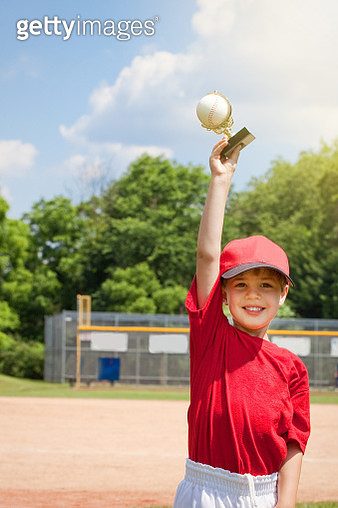 Young Boy Happy Holding Baseball Trophy - gettyimageskorea