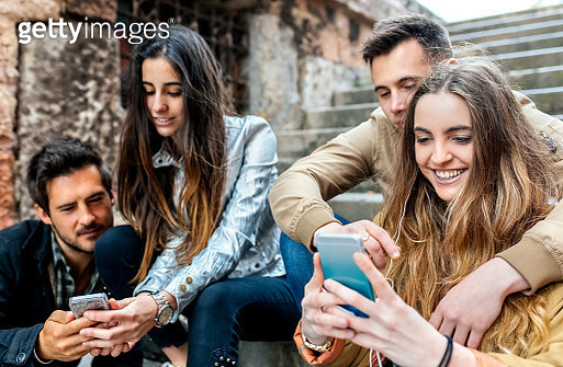 Group of friends sending messages with the smartphone - gettyimageskorea