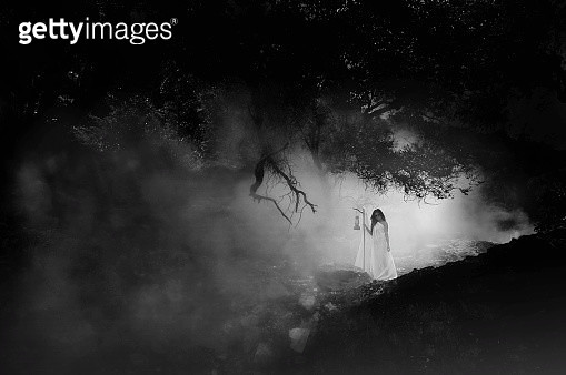 Woman Standing In Forest During Foggy Weather - gettyimageskorea