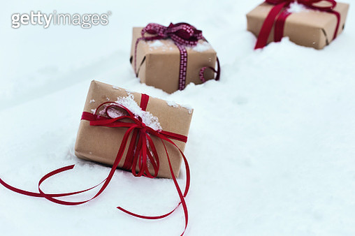 Christmas presents in snow - gettyimageskorea