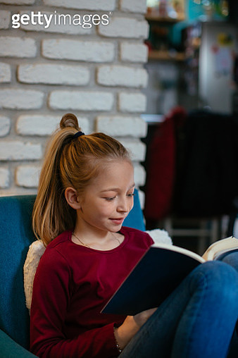 Beautiful blond girl reading book - gettyimageskorea