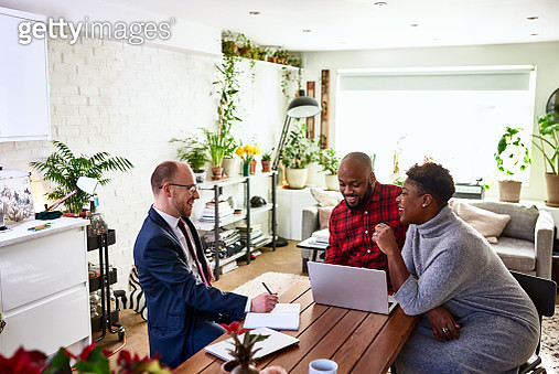 Couple sitting at dining room table with insurance agent, support, solutions, conversation - gettyimageskorea