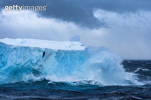 Massive Iceberg floating in the Southern Ocean in Antarctica with stormy seas - gettyimageskorea