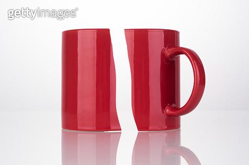 Halved Damaged Red Mug Cup - gettyimageskorea