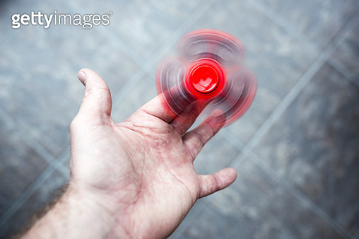 Red fidget spinner - gettyimageskorea