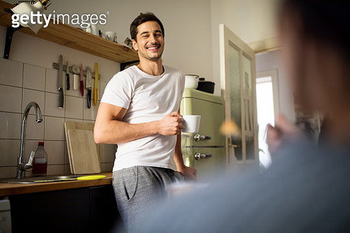 Man having coffee at home in morning - gettyimageskorea