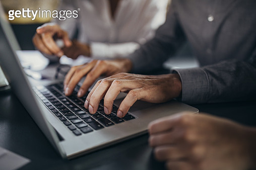 Close up of unrecognizable businessman typing on laptop. - gettyimageskorea