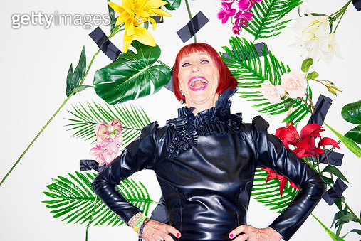 older woman laughing in couture clothing - gettyimageskorea