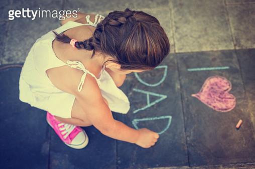 Overhead view of girl writing on the sidewalk - gettyimageskorea