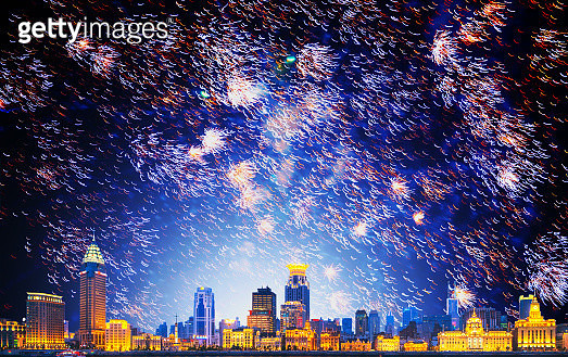 Fireworks over illuminated cityscape - gettyimageskorea