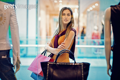 Young beautiful girl is shopping in the Mall - gettyimageskorea