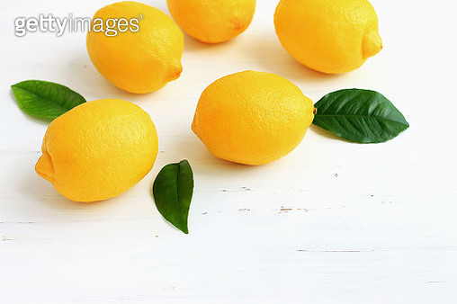 yellow lemons on white wooden background - gettyimageskorea