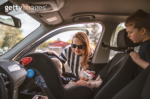 Woman in Car with her Boys traveling together - gettyimageskorea