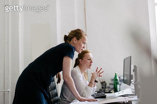 Two women working in an Office - gettyimageskorea