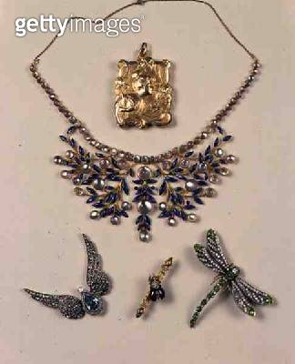 <b>Title</b> : Fine Jewellery, clockwise from top: Art Nouveau gold locket by Jean-Baptiste Emile Dropsy (1858-1923); a moonstone, gold and ena<br><b>Medium</b> : <br><b>Location</b> : <br> - gettyimageskorea