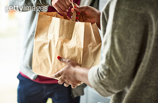 Close up of woman receiving take away food delivery - gettyimageskorea