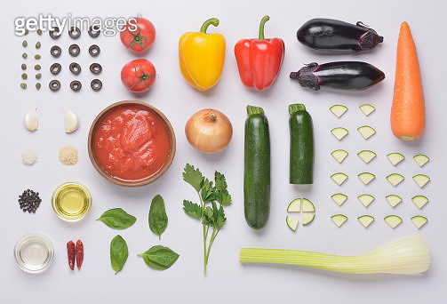 Caponata the traditional cuisine of Sicily and Naples.Variety of Caponata organized in knolling arrangement. Items include:Whole tomatoes, tomato, capers, black olives, garlic, salt, pepper, sugar, olive oil, white wine, red pepper, basil, Italian parsley - gettyimageskorea
