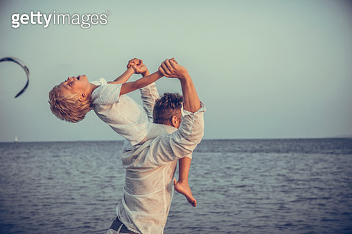 Father and son on sunset beach - gettyimageskorea