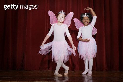 Girls (6-9) performing ballet on stage, smiling - gettyimageskorea