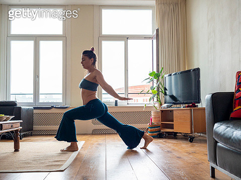 Practicing yoga at living room in the morning - gettyimageskorea