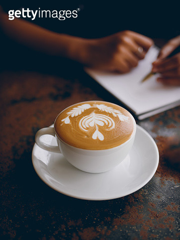 Close-Up Of Cappuccino On Table - gettyimageskorea