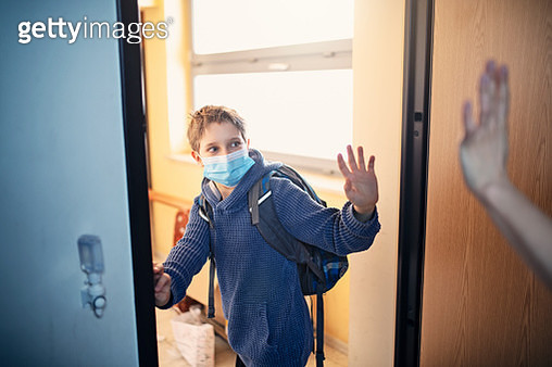 Little boy leaving for school during COVID-19 pandemic - gettyimageskorea