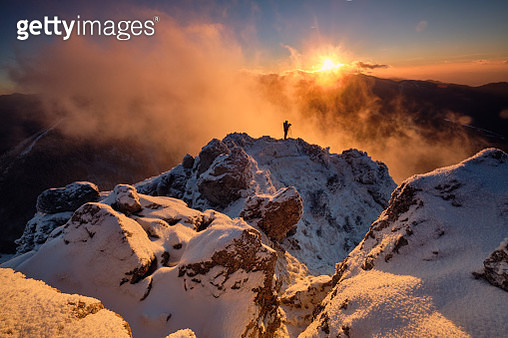 Silhouette Man On Snowcapped Mountains Against Sky During Sunset - gettyimageskorea