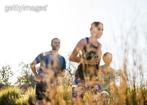 Shot of a fitness group running together outdoors in park - gettyimageskorea
