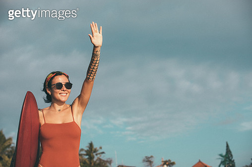 Woman with surfboard - gettyimageskorea