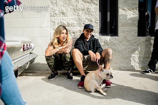 Latinx couple with French bulldog - gettyimageskorea