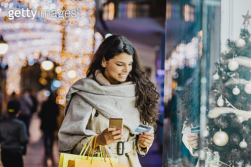 Young woman shopping for Christmas - gettyimageskorea