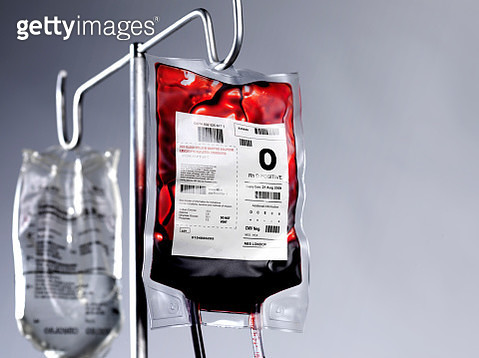 Blood bag and saline drip on hospital stand - gettyimageskorea