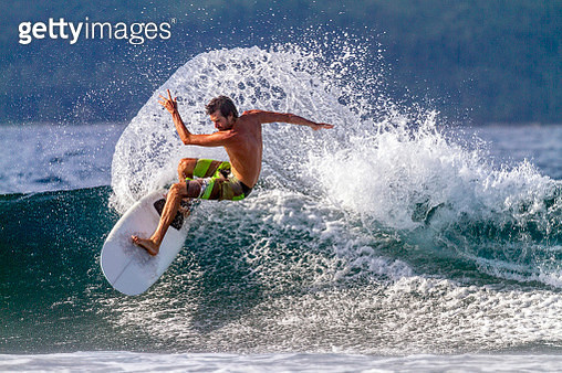 The Philippines, Mindanao, Davao Oriental, surfing in the Pacific Ocean - gettyimageskorea