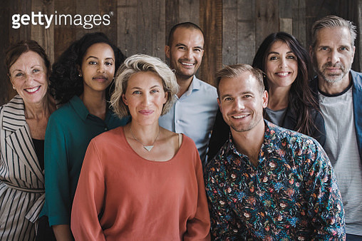 Portrait of confident multi-ethnic business people in portable office truck - gettyimageskorea