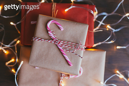 High Angle View Of Christmas Presents And Lights On Table - gettyimageskorea