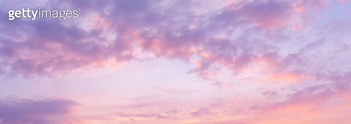 UK, London, full frame panorama of soft pastel pink and violet clouds at sunset - gettyimageskorea