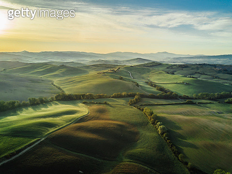 Tuscany landscape at sunrise with low fog - gettyimageskorea