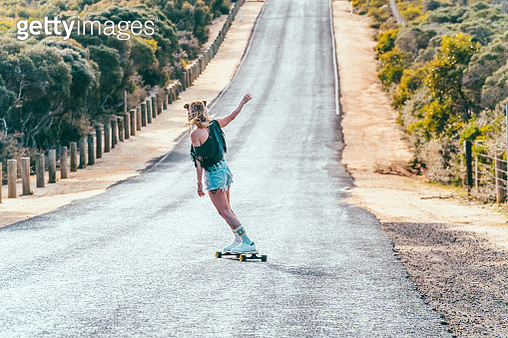 woman with a longboard skate - gettyimageskorea