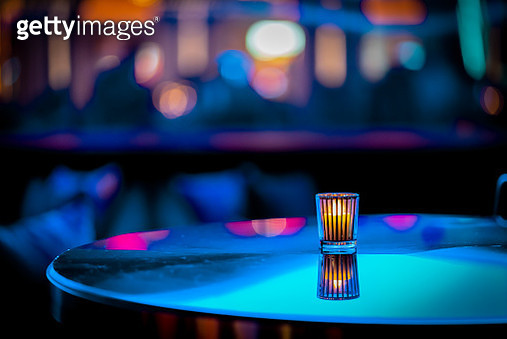 Minimalistic or abstract candle on table at a nightclub with out of focus background -- teal, blue and pink bokeh - gettyimageskorea